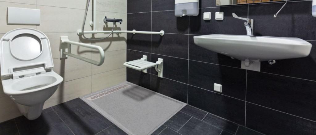 Receveur à grille salle de bains handicapé